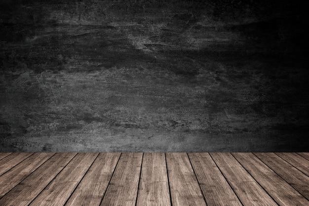Plancher en bois vide avec fond de mur en béton foncé, pour la présentation du produit. Photo Premium