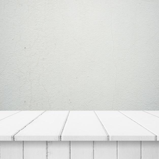 Les planches en bois avec un mur blanc Photo gratuit