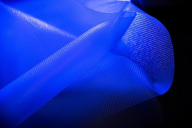 Plastique De Couleur Bleue. Protection Environnementale. Utilisation Des Déchets. Photo Premium
