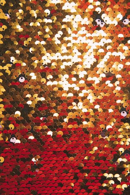 Plein cadre de paillettes brillantes d'or en arrière-plan Photo gratuit