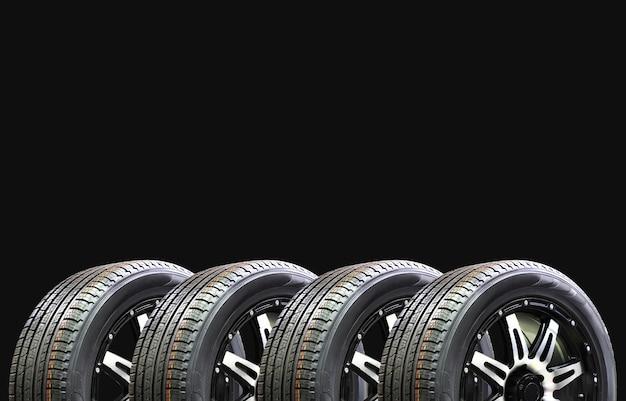 Pneus de voiture sur fond noir Photo Premium