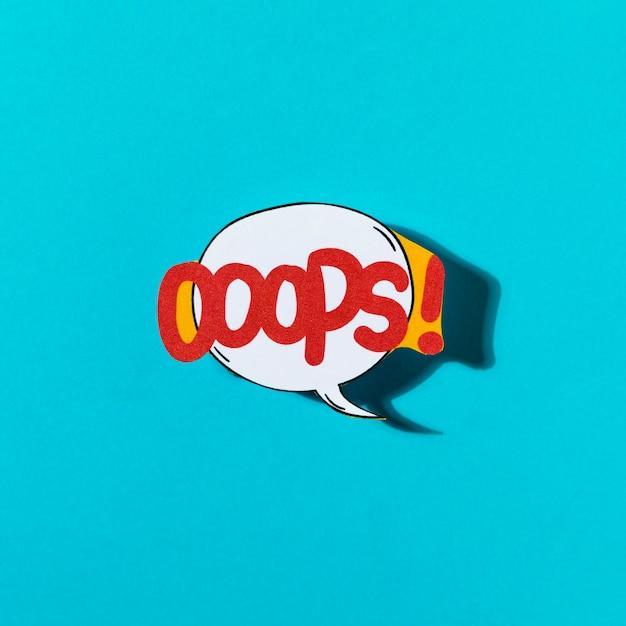 Pop art et bande dessinée oops bulle de dialogue sur fond bleu Photo gratuit