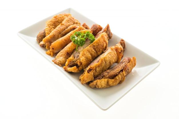 Porc croustillant frit isolé sur fond blanc Photo gratuit