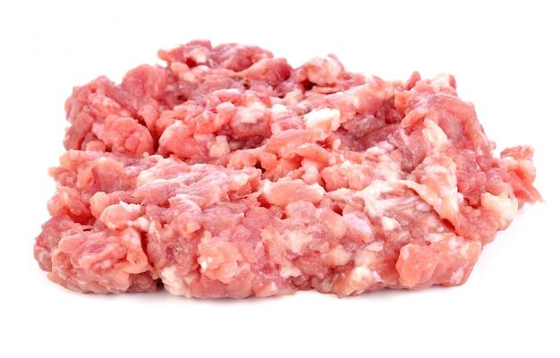 Porc haché sur fond blanc Photo Premium