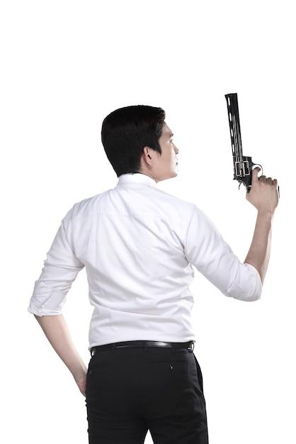 Portrait d'agent srcret tenant une arme à feu Photo Premium