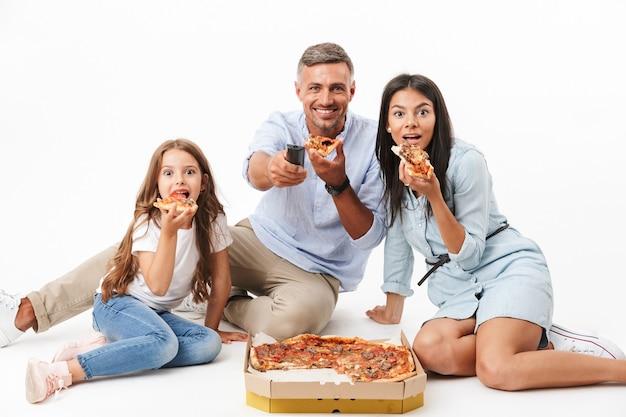 Portrait D'une Famille Heureuse, Manger De La Pizza Photo Premium