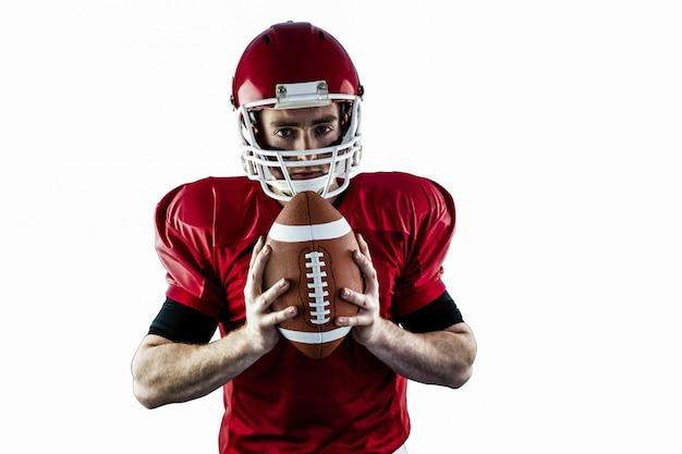 Portrait, de, football américain, concentré, tenue, football Photo Premium