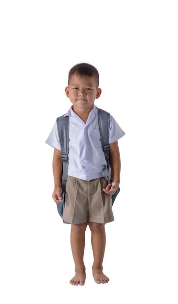 Portrait de garçon de pays asiatique en uniforme scolaire isolé sur fond blanc Photo Premium