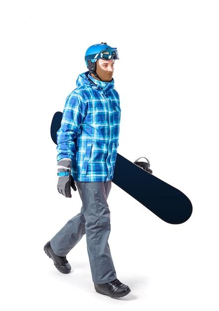 Portrait de jeune homme en tenue de sport avec snowboard isolé Photo Premium