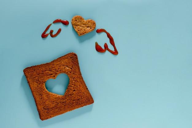 Pose plate de tranches de pain grillé en forme de cœur et d'ailes Photo Premium