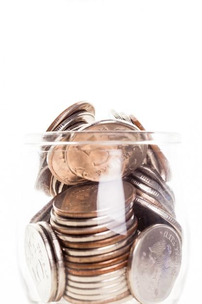 Pot d'argent avec des pièces Photo Premium