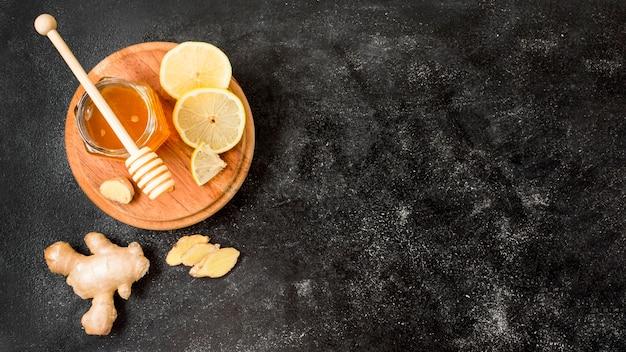 Pot de miel au gingembre et au citron, vue de dessus Photo gratuit