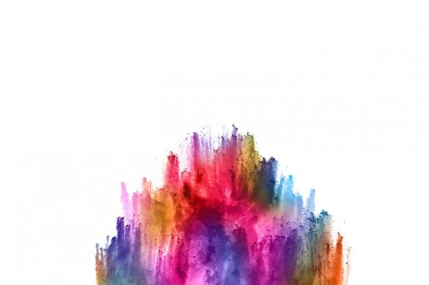 Poudre abstraite éclaboussée de fond. explosion de poudre colorée sur fond blanc. Photo Premium