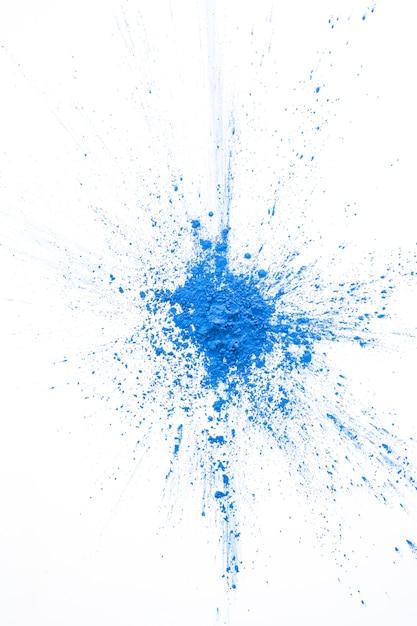 Poudre bleue peinte sur la table Photo gratuit