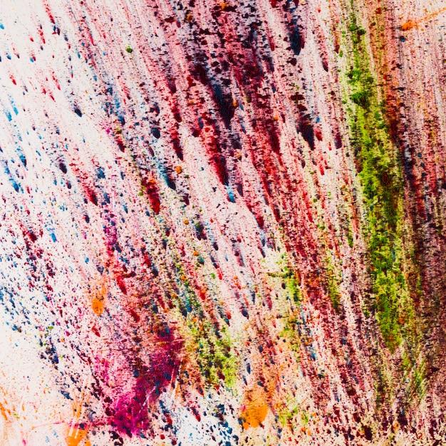 Poudre de holi coloré indien éclaboussant sur fond blanc Photo gratuit