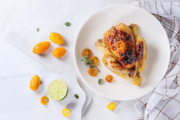 Poulet frit aux kumquats Photo Premium