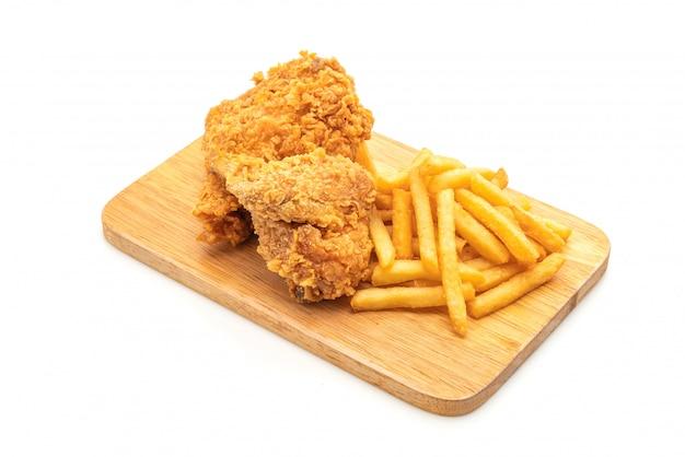 Poulet frit avec frites et pépites (malbouffe et aliments malsains) Photo Premium