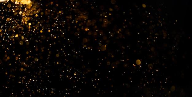 Poussière Dorée Abstraite Sur La Surface Noire Photo Premium