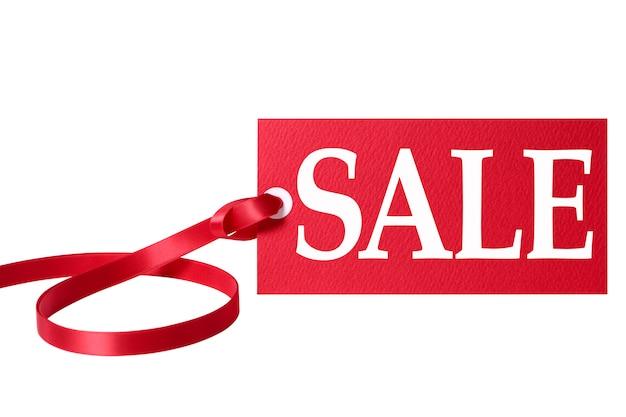 Prix de vente tag avec un ruban rouge Photo gratuit
