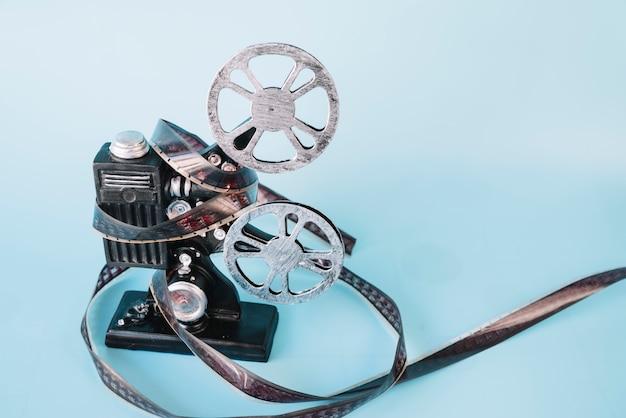 Projecteur de film avec bobine de cinéma Photo gratuit