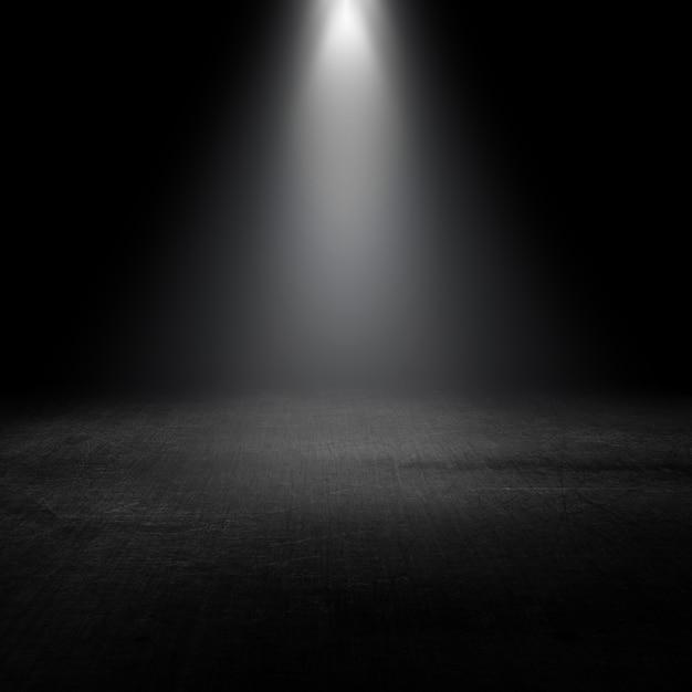 Projecteur qui brille dans un intérieur grunge Photo gratuit