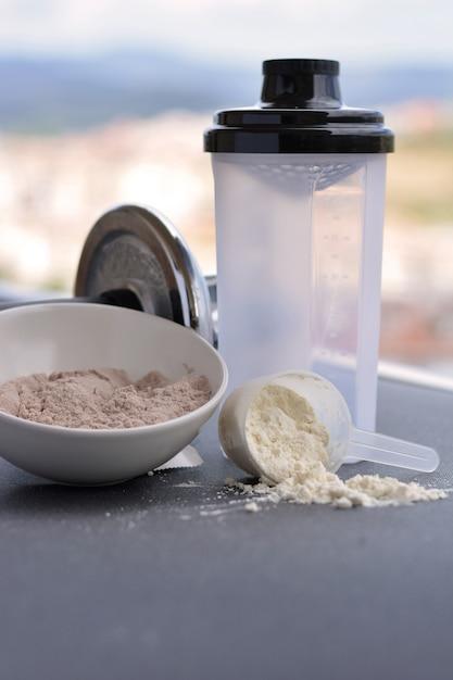 Protéines de lactosérum goût vanille et chocolat Photo Premium