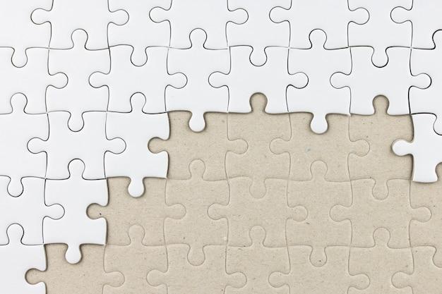 Puzzle blanc comme toile de fond Photo Premium