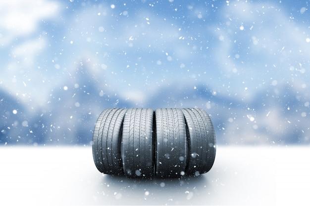 Quatre pneus de voiture sur une route enneigée Photo Premium
