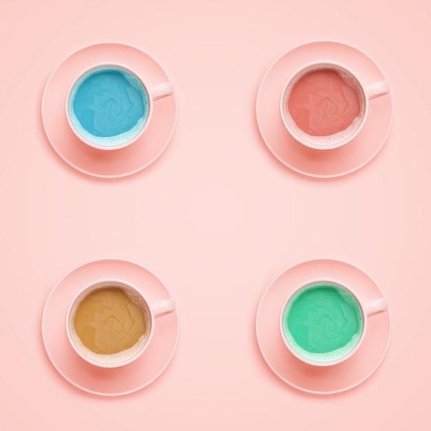 Quatre tasses à café de couleurs différentes. style minimal Photo Premium
