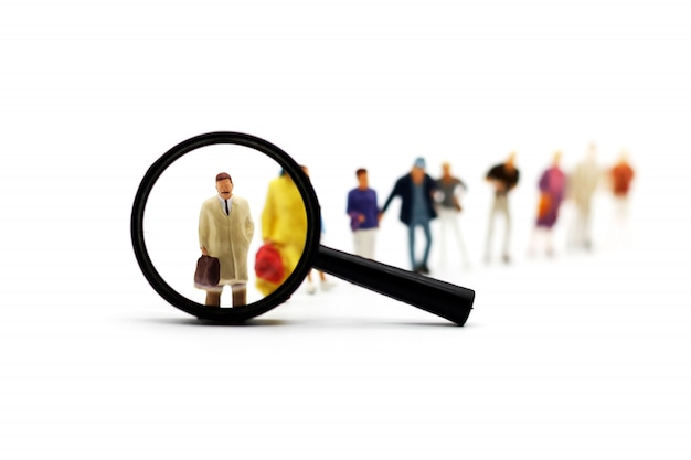 Recrutement zoom loupe picking homme d'affaires groupe de personnes candidates. Photo Premium