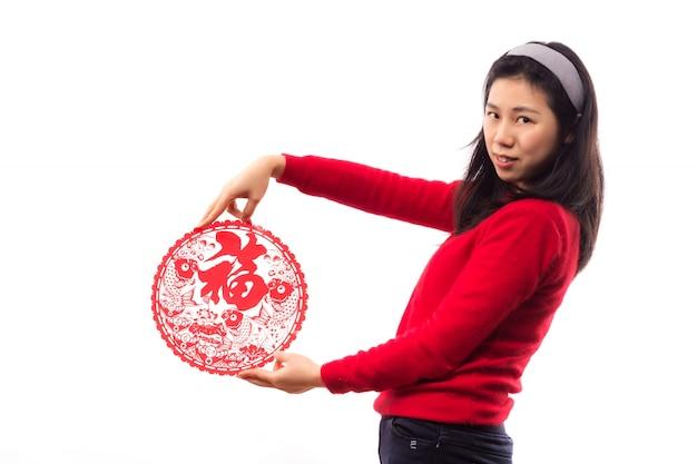 Regardant célébrer l'année dame asiatique Photo gratuit