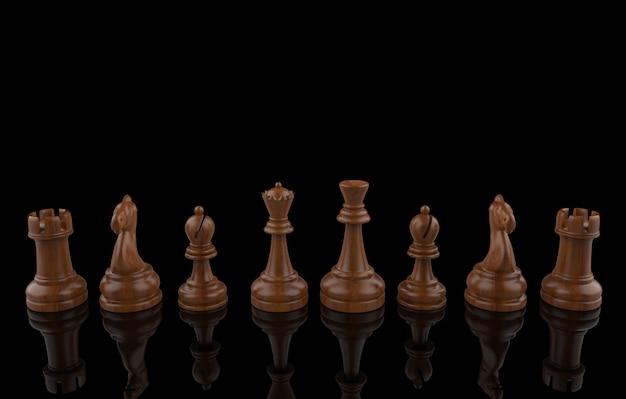 Rendu 3d. équipe de collection de jeu d'échecs en bois sur fond noir. travail en équipe . Photo Premium
