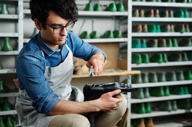 Réparation de chaussures Photo gratuit