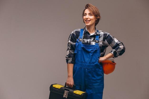 Réparatrice en uniforme avec boîte à outils Photo gratuit