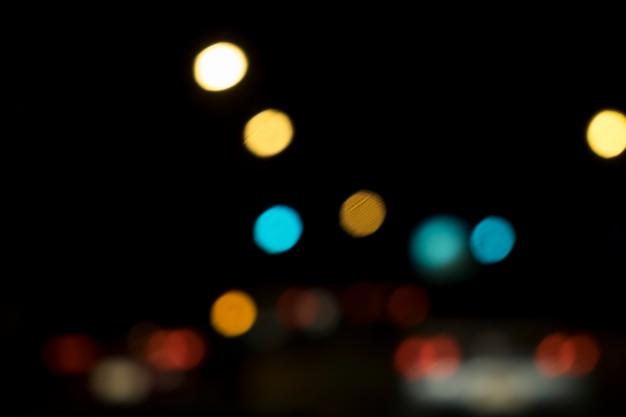 Résumé bokeh flou lumières nuit dans l'arrière-plan de la ville de la rue. Photo gratuit