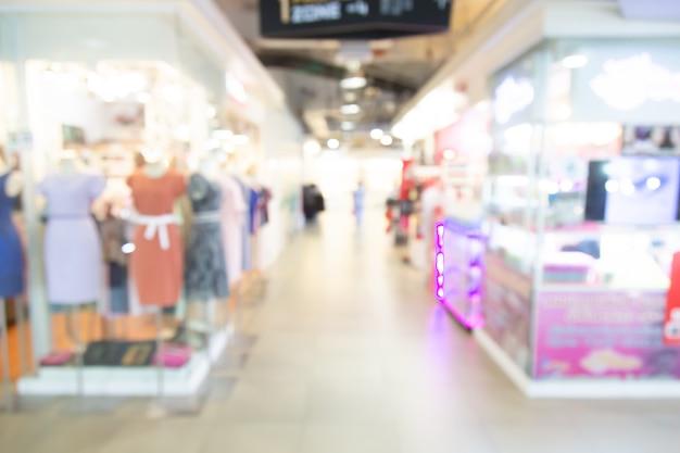 Résumé centre commercial floue du grand magasin avec fond de gens Photo Premium
