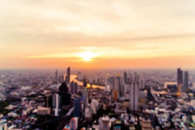 Résumé flou paysage urbain de bangkok en thaïlande avec ciel coucher de soleil Photo Premium