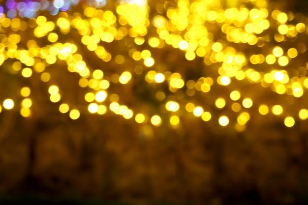 Résumé De Lumières De Noël Avec Bokeh Jaune Brillant Photo Premium