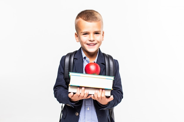 Retour à L'école. Livres, Pomme, école, Enfant. Petit étudiant Détient Des Livres. Joyeux Petit Enfant Souriant Contre Le Tableau Noir. Concept D'école Photo gratuit