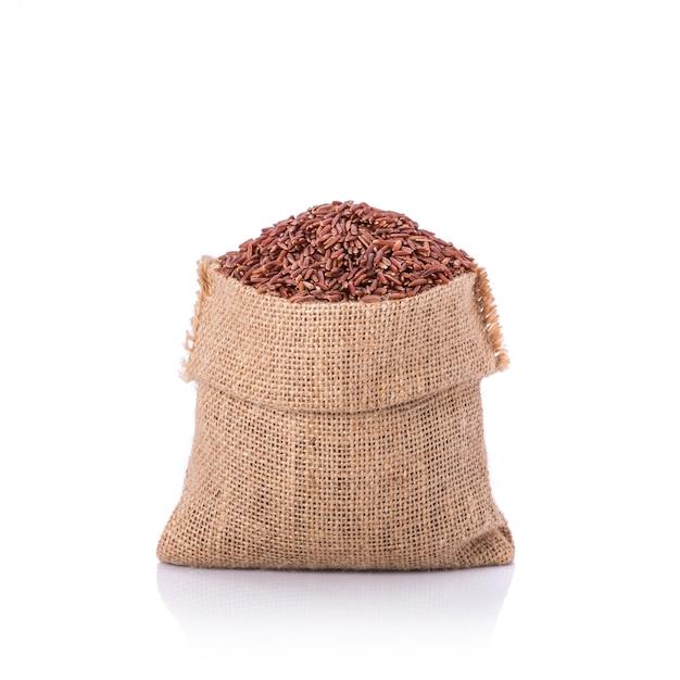 Riz au jasmin rouge thaïlandais dans un petit sac Photo Premium