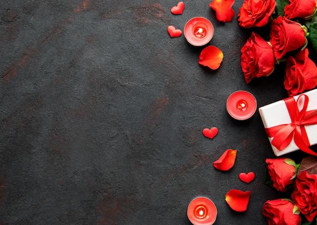 Roses Et Bougies Avec Cadeau Photo Premium