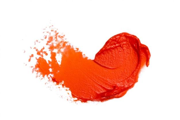 Rouge à lèvres sur blanc Photo Premium