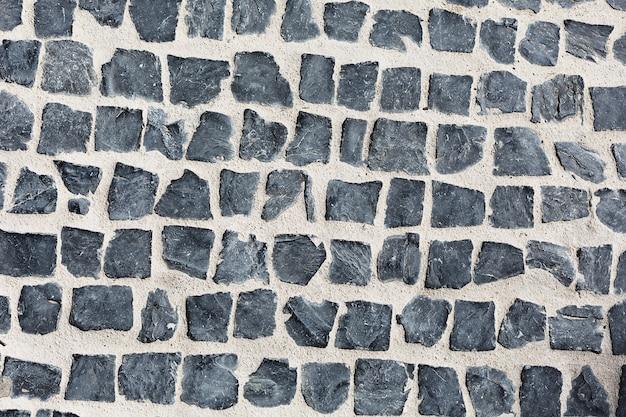Route pavée de pierres carrées grises Photo Premium