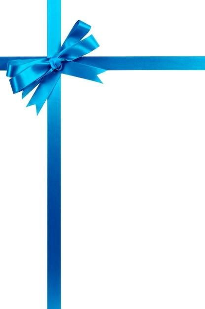Ruban cadeau bleu clair et archet isolé sur blanc. Photo gratuit