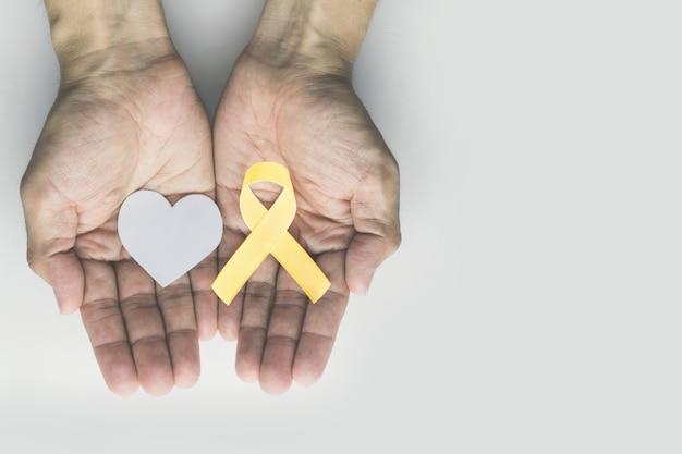Ruban d'or de sensibilisation au cancer infantile Photo Premium