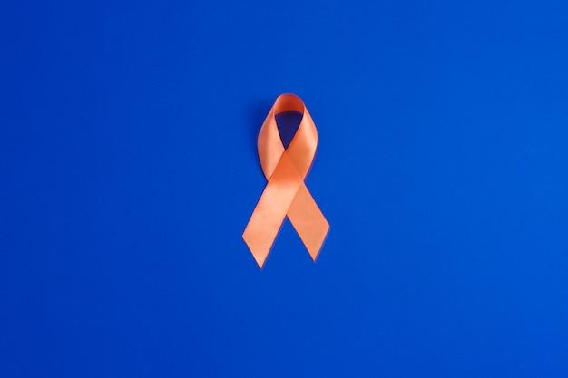 Ruban orange. conscience de la leucémie. concept de soins de ...