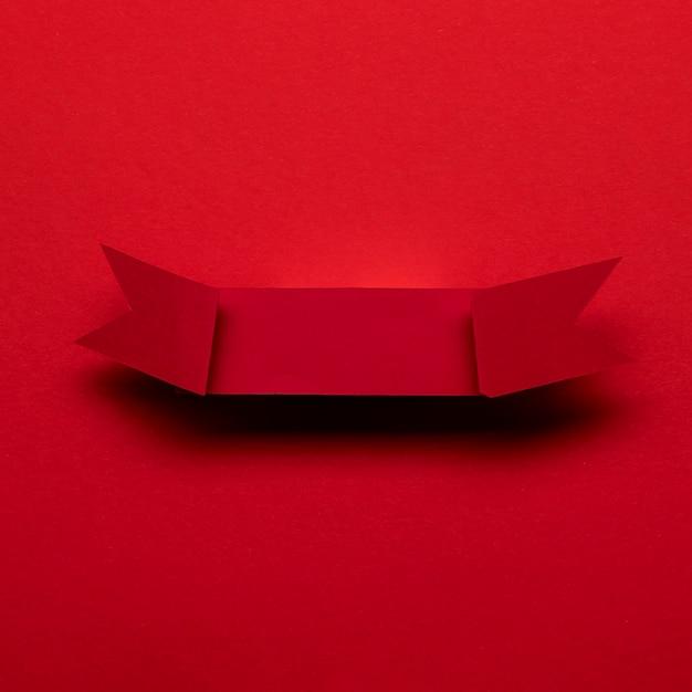 Ruban Rouge Sur Fond Rouge Concept De Vendredi Noir Photo gratuit