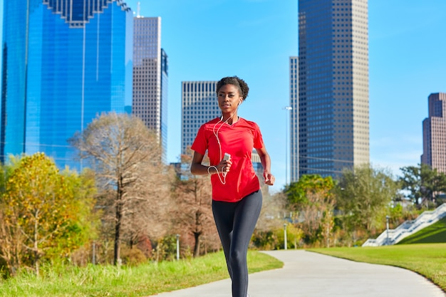 Runner girl running écoute de la musique écouteurs Photo Premium