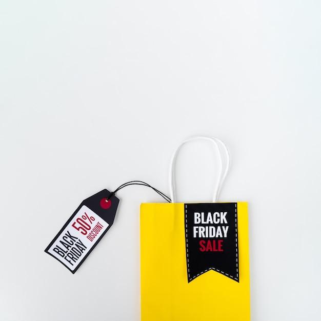 Sac shopping noir avec étiquette Photo gratuit