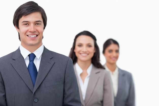 Salesteam souriant faisant la queue Photo Premium